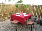 Peaceful private patio with BBQ & seating with each cottage - perfect for breakfast thru star gazing