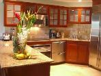 A gourmet top-of-the-line kitchen with granite counter tops and stainless appliances: Sub-Zero fridg