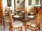 Indoor dining table set for dinner.