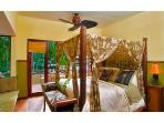 The Master Bedroom has a romantic four poster bed and canopy.