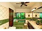 The Master Bath has handpainted sinks, tub, bidet and private garden.