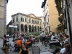 cortona piazza with coffee bars and Signorelli theatre
