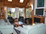 Middle endry level living room with wall mounted flat screen cable TV/Blu-Ray DVD, electric fireplace, couch, loveseat...
