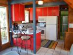 Fully equipped kitchen-no dishwasher-with a breakfast bar for two.