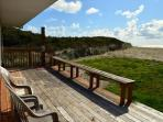 Ocean facing deck with patio furniture, built-in benches, charcoal BBQ, outdoor shower and very easy beach access.
