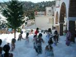 Foam dancing in the village square at the Fiera, Summer
