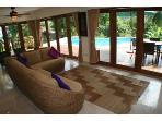 Living Area Opens to the Sundeck and Pool. All doors open to allow sea breeze to flow through Villa