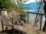 The large Seaside deck has water views and Coastal Mountain views of Cypress Mtn. Ski Resort.