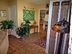 Your tropical entry foyer leads to your living room (left) and large kitchen (right)