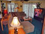 Comfy living room with huge 70' Toshiba projection TV (+ Digital Video Recorder and web-enabled DVD)