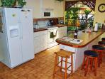 Here\\\'s your \'cooking-socializing\' kitchen with garden solarium behind.