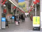 Bustling Shugakuin neighborhood with shops and local station