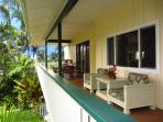 Spacious wraparound lanai with BBQ dining table and seating area