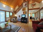 The Cabin: From the living room into the kitchen and up to the loft and that soaker tub for two.
