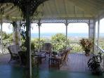 The main Veranda with panoramic Caribbean Sea and mountain views