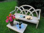 Watch the birds or enjoy a pretty sunset from the English garden bench in the back yard.