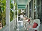Furnished Front Porch Area with a Great Tropical Island View.