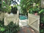 Entrance to shared heated pool with beautiful landscaping