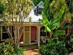 Enter Through Lush Landscaping Through Tropical Gardens