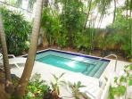 Relax By The Heated Pool At Palm Gardens