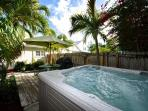 Your Private Jacuzzi and Furnished Deck Area Complete With A Grill For Your Outdoor Cooking/Dining Enjoyment