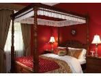 Scarlett  queen four-poster bedroom bathed in fine linen