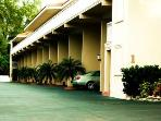 Our Building 1 & covered parking - by last small palm
