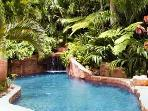 The resort quality, lagoon pool with waterfall and grotto.