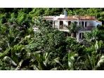 A Secure & Gated Property, Surrounded by 3 Acres of Lush Tropical Landscaping.