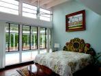 Fifth bedroom, poolside of hall