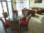 Casa Caribbean soul dining room that opens to the beach & Tankah Bay