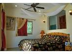 Downstairs Air Conditioned Bedroom with glass slider that opens onto the beach and Tankah Bay