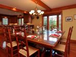 Dining room can seat up to 16 at table, plus 4 at bar counter, plus 4 in adjoining sunroom.
