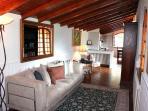 Livingroom with wood burning fireplace