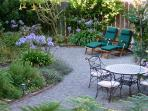 Well Maintained Garden. Wrought Iron Table & Chairs. Teak Deck Chairs. Enjoy Morning Coffee. Relax!