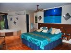 Master Suit with In-Room 2 Person Jetted Tub , Leather Furniture, Covered Deck, Desk