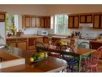 The spacious kitchen: ample counterspace, Corian countertops, & breakfast area