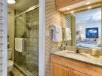 En suite bathroom with step in shower.