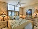 Comfortable king bed. Keep the doors open to hear the ocean!