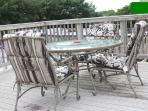 Comfortable patio furniture and table on our deck