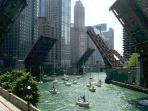Bridges up on the Chicago River with sailboats heading towards Lake Michigan in Spring.