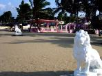 Two Lions Watch Over The Beach At Villa Leone