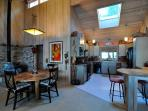 The cheerful kitchen, dining area, and wood stove.
