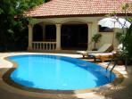 THE VILLA SITS IN SECLUSED PEACEFUL GARDENS