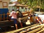 DOWNTOWN: Tourist helping boat builders
