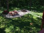 Picnic table and stone fire pit, view from the deck