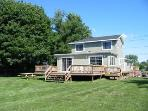 Gather with family and friends on your private backyard deck and a large fenced in backyard.