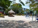 Playground Area W/BBQ & Tiki Huts