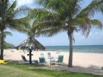 Gentle Winds beach is sandy and clear. There are plenty of beach chairs and lounge chairs for you