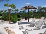 Sandy Poolside Beach Area w/BBQ & Tiki Huts